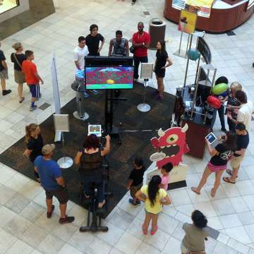 Mall Shoppers Take on Goji Play on Elliptical Trainers